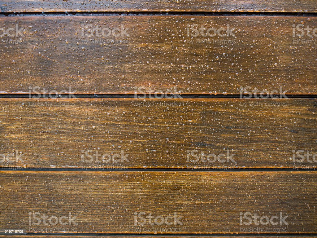 Many water drops on wooden surface stock photo