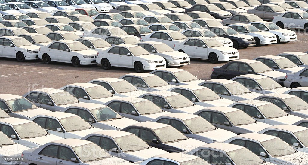 Many white cars in a parking lot stock photo
