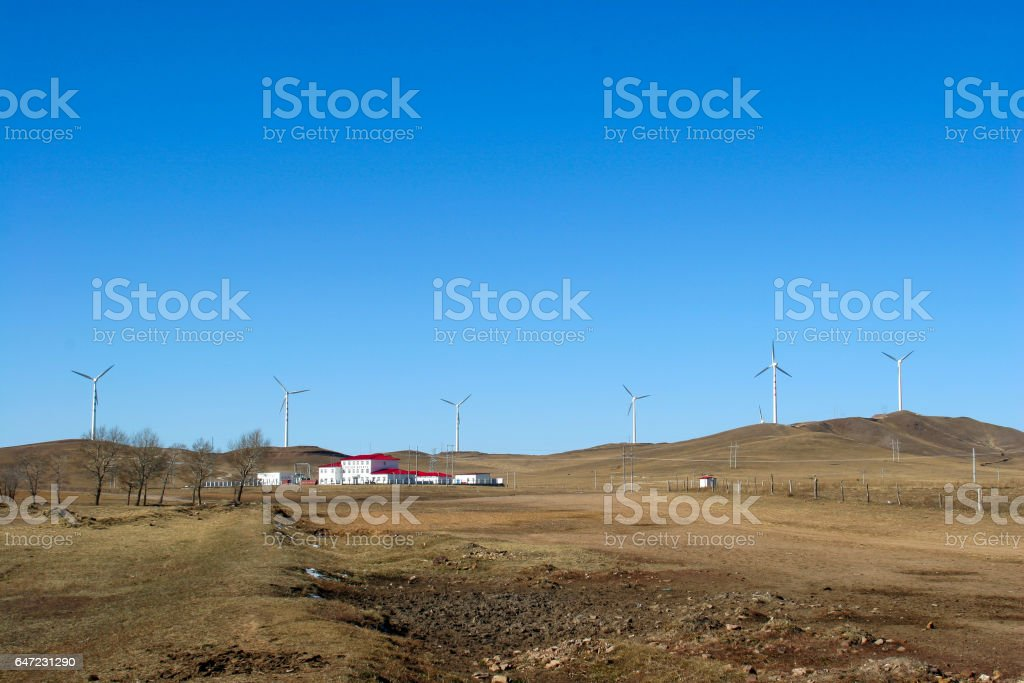 many wind power generator on grass hills stock photo