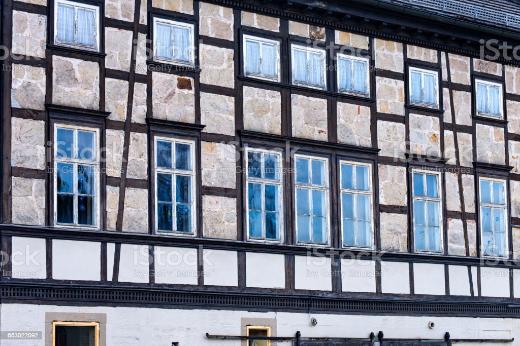 Many windows in an old half-timbered house stock photo