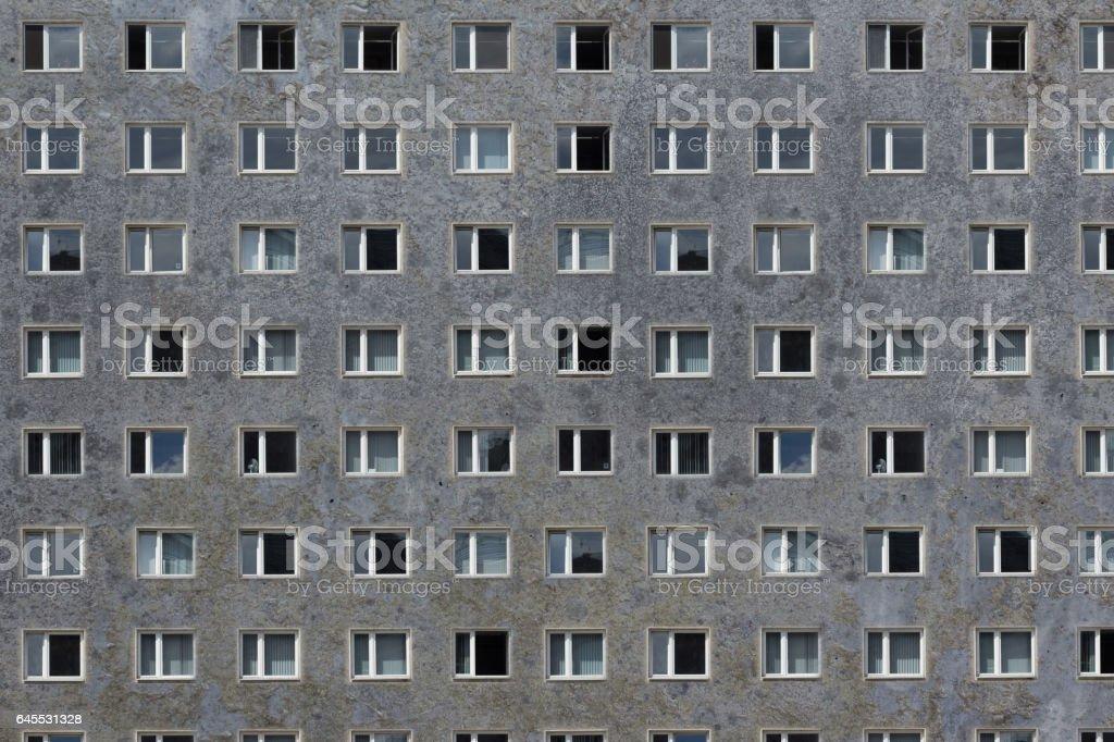 many windows on grey building facade - plattenbau stock photo