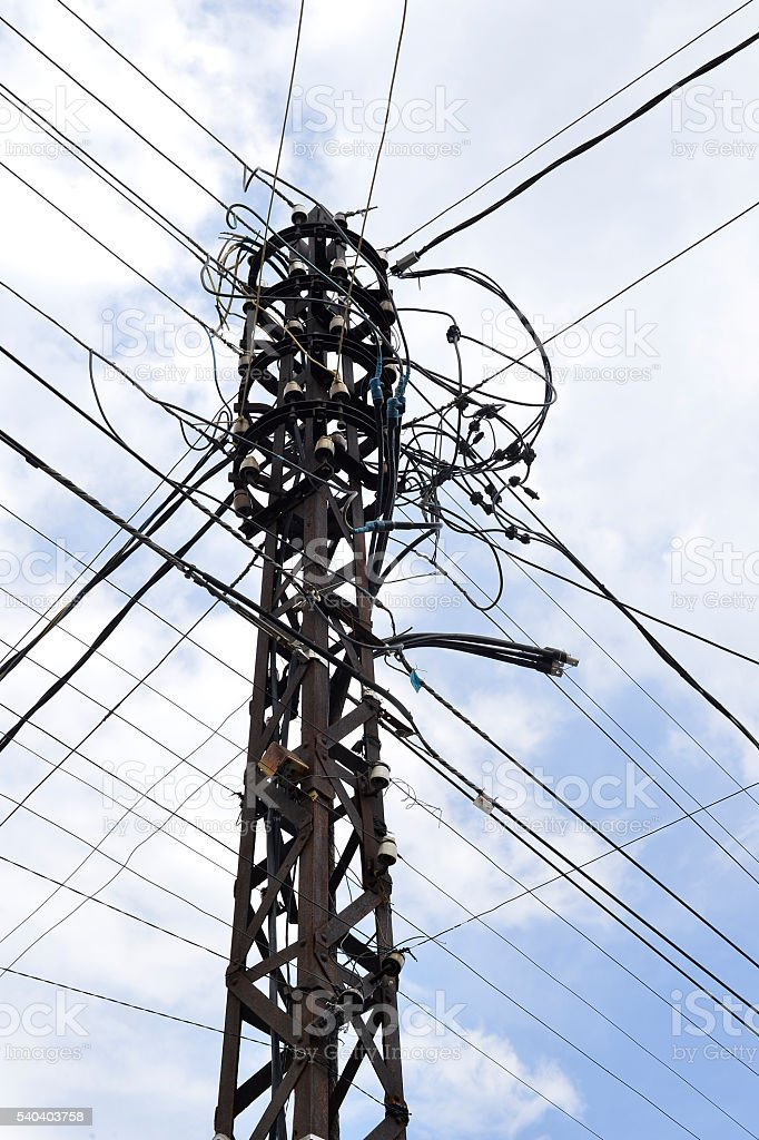 Many wires on an old electric pole stock photo