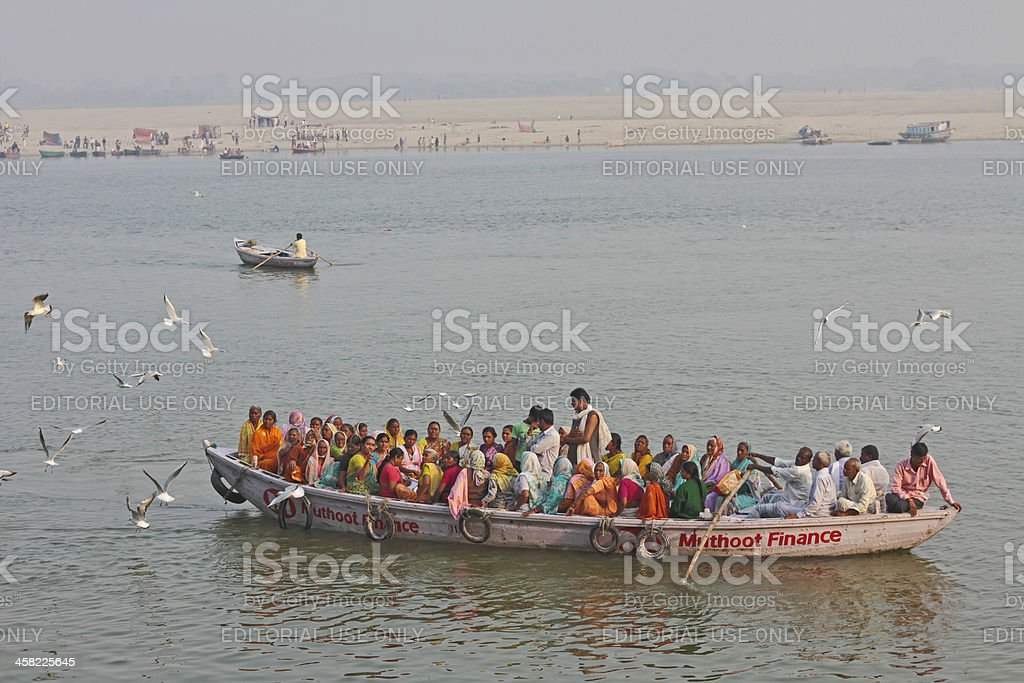 Many women in a boat stock photo