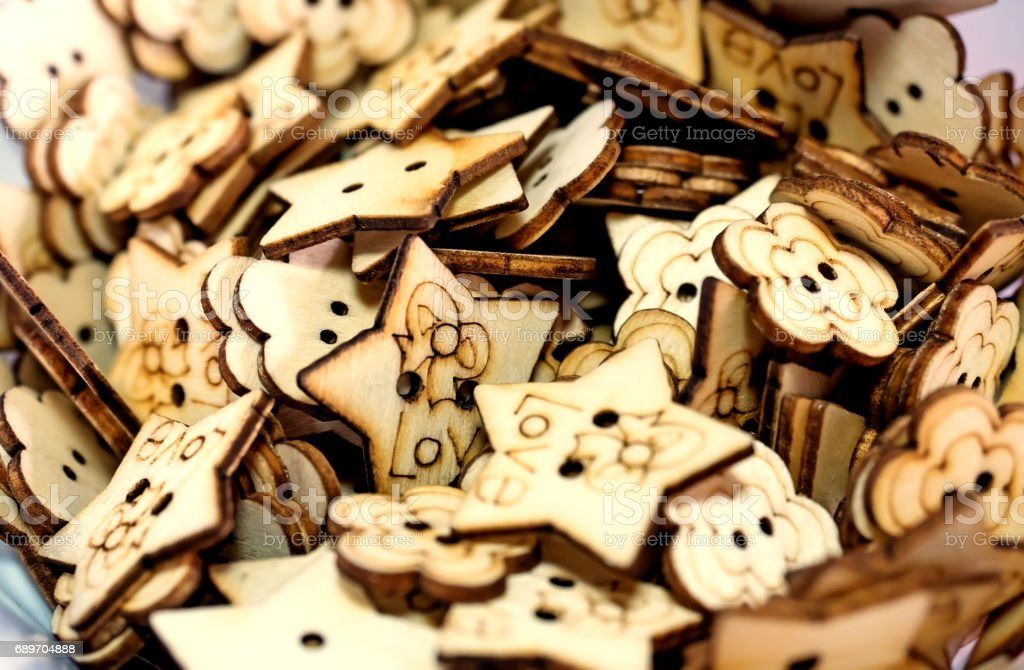 Many wooden handmade buttons, shallow depth of field stock photo