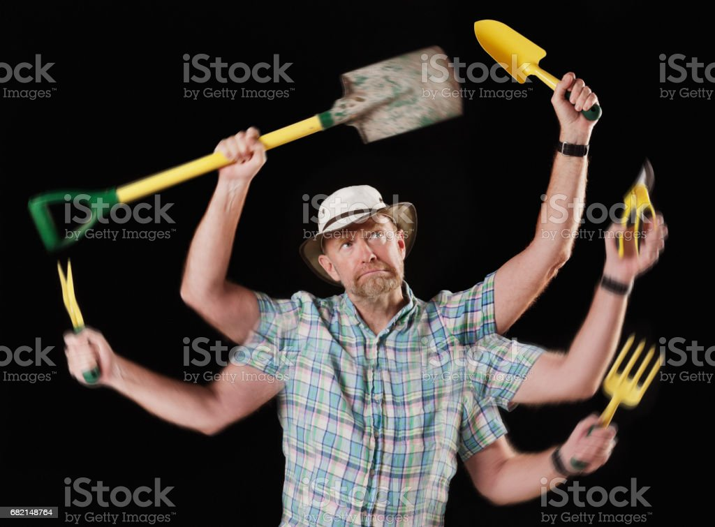 Many-armed man multitasking in the garden looks tired and resentful, stock photo