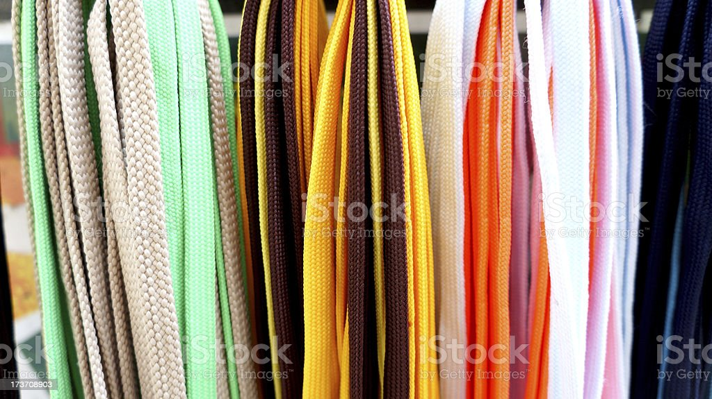 Many-coloured shoestrings royalty-free stock photo