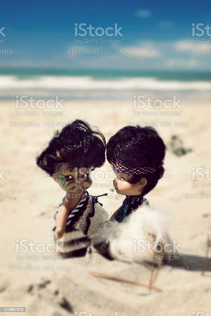 Maori Souvenir Dolls on Beach, New Zealand stock photo