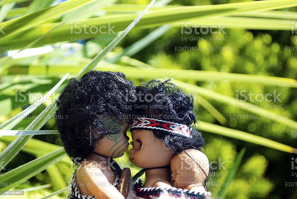 Maori Souvenir Dolls with New Zealand Flax Background royalty-free stock photo