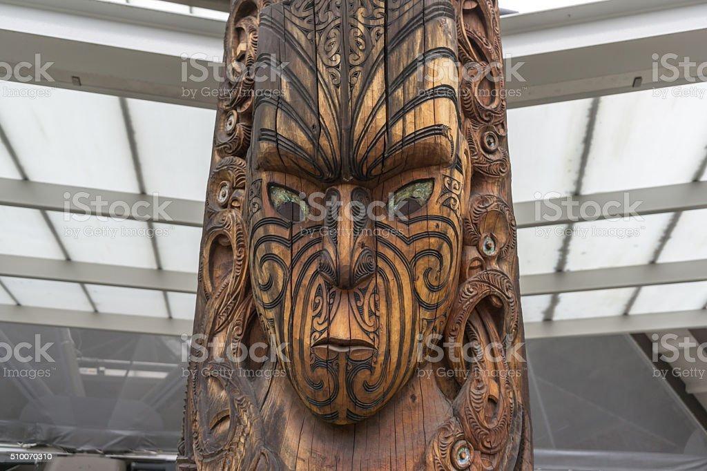 maori wooden statue stock photo