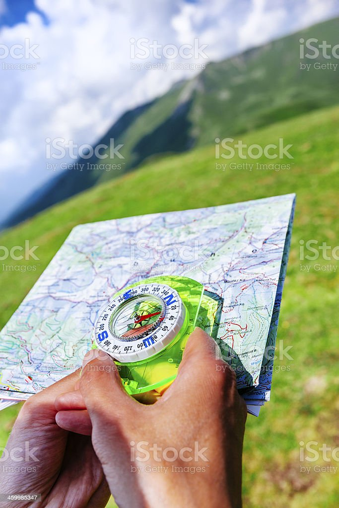 Map and compass work stock photo