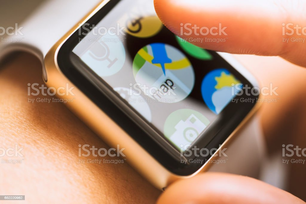 Map application on smart watch touchscreen stock photo