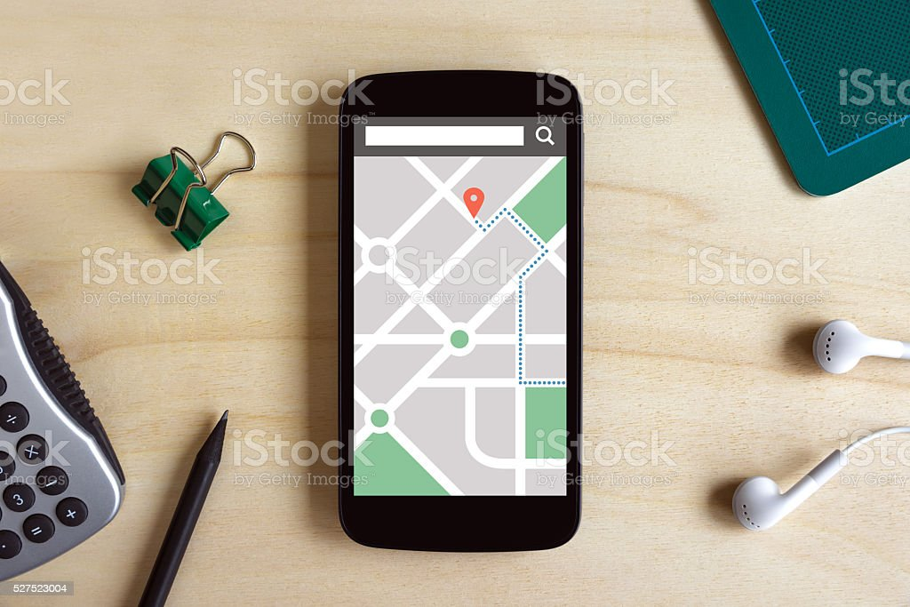 Map gps navigation application on phone screen on wooden desk stock photo