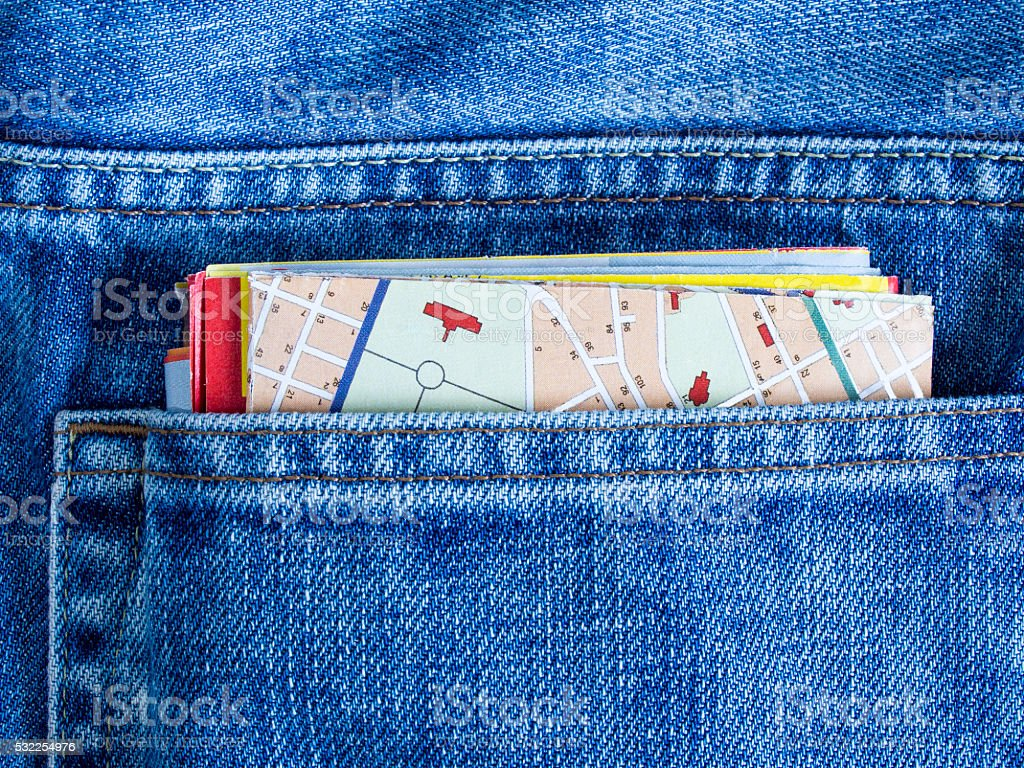 Map in blue jeans pocket. stock photo