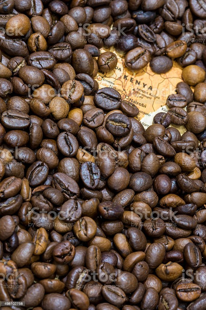 Map of Kenya under a background of coffee beans stock photo