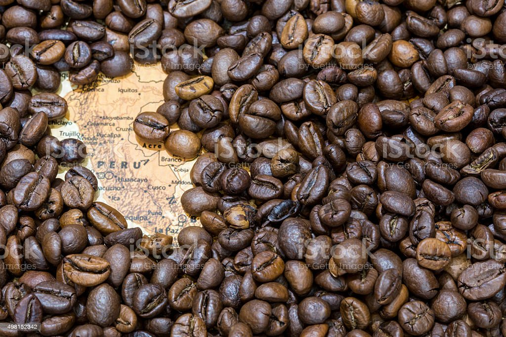 Map of Peru under a background of coffee beans stock photo