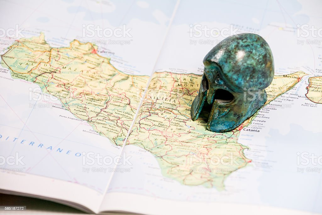 Map of Sicily and paperweight stock photo