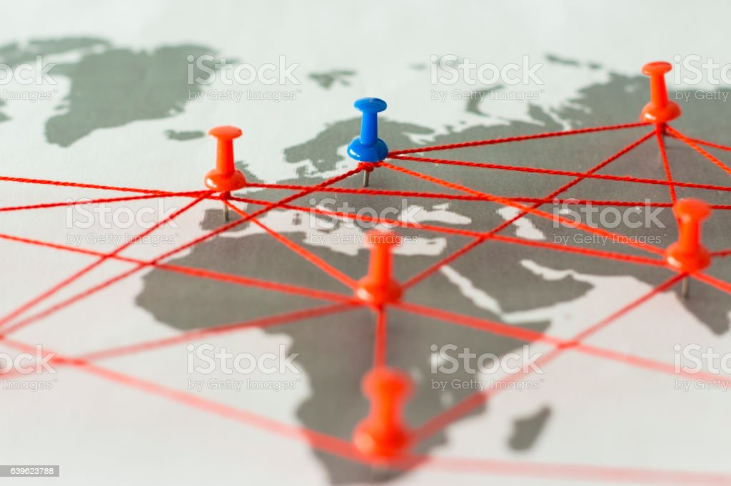 Map of the world connected by thumbtacks stock photo