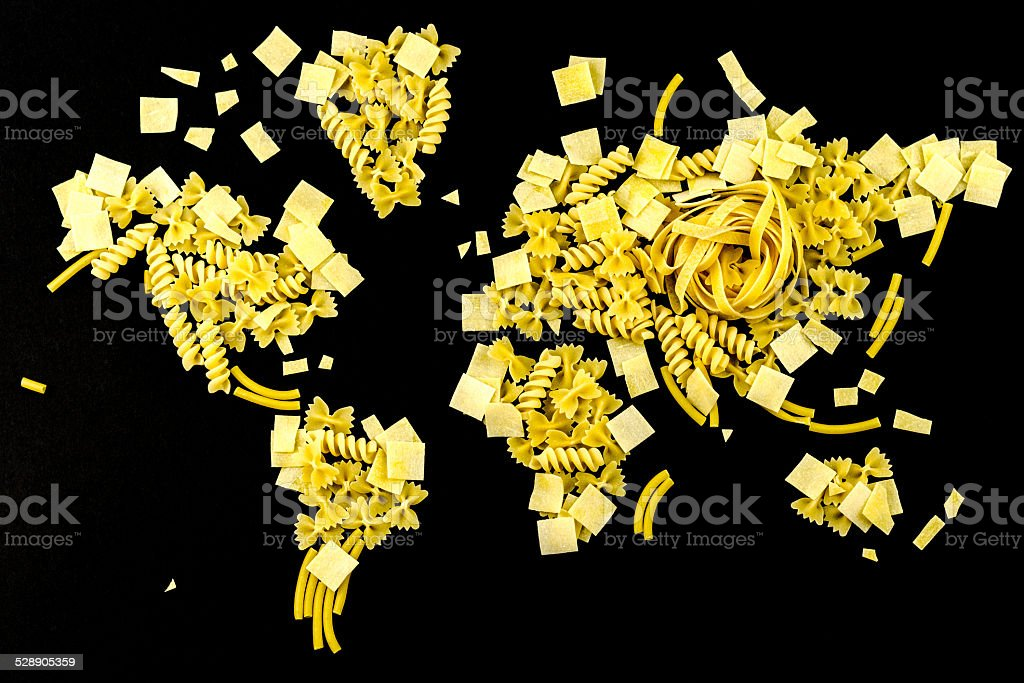 map of the world made of pasta on black background stock photo