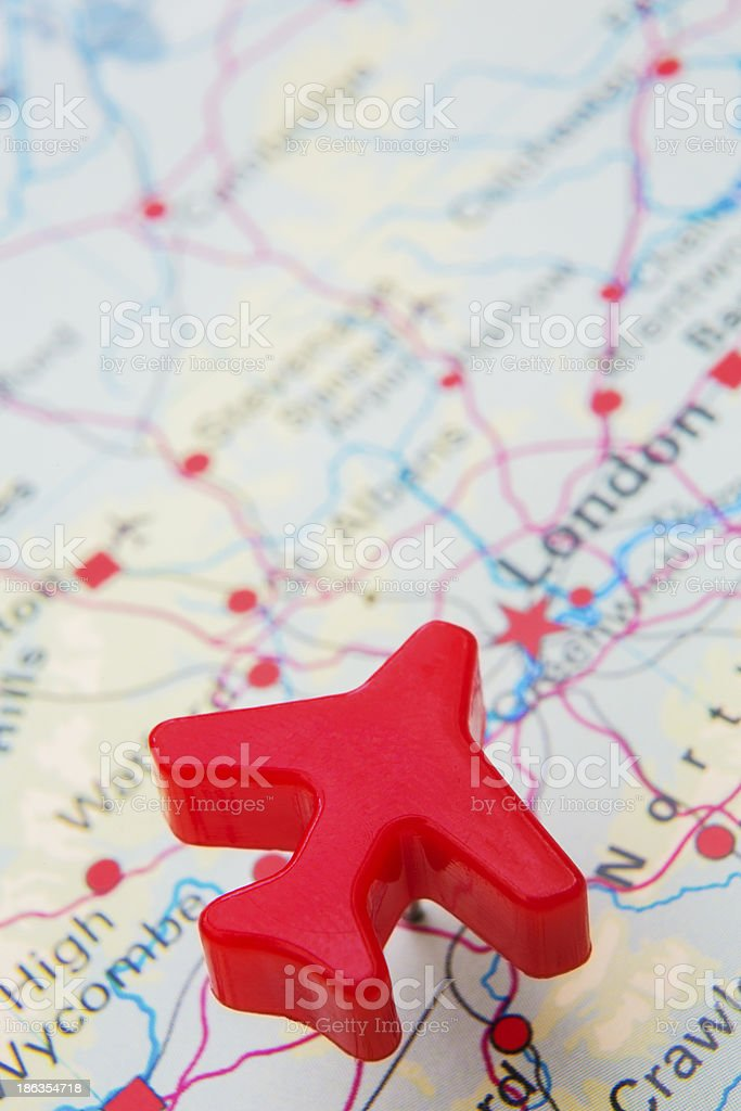 Map Of United Kingdom With Model Plane Over London royalty-free stock photo