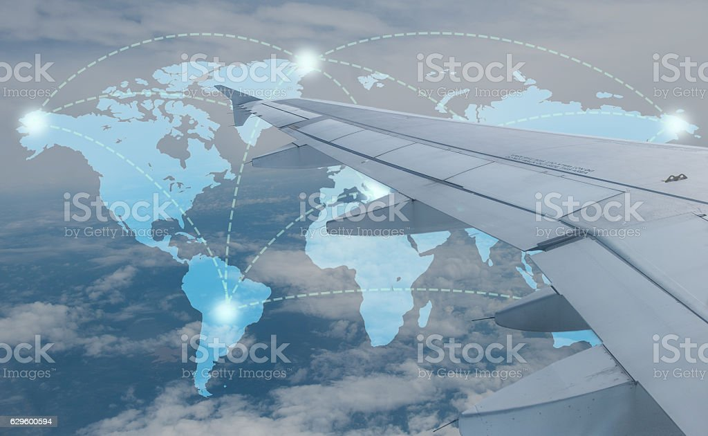 Map over sky with airplane wing stock photo
