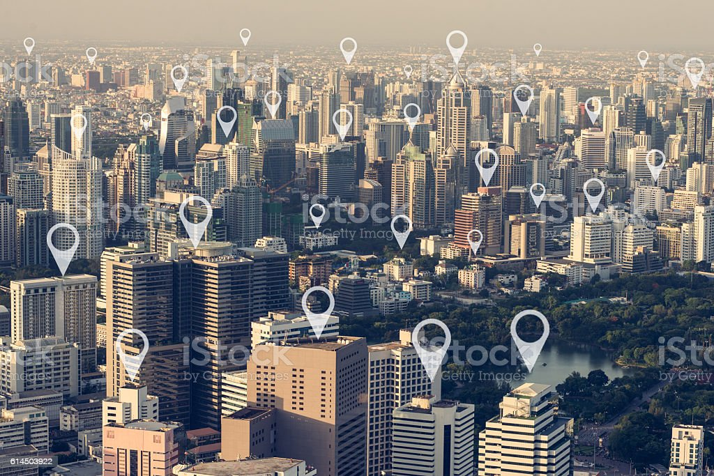 Map pin flat above city scape,technology concept stock photo