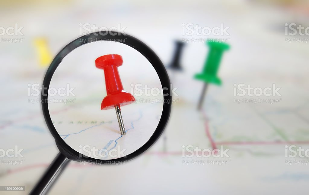 Map tacks magnified stock photo