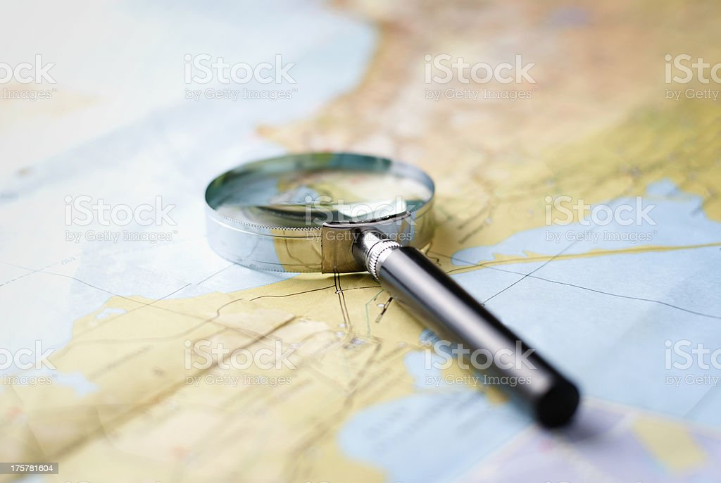 Map with a magnifying glass royalty-free stock photo