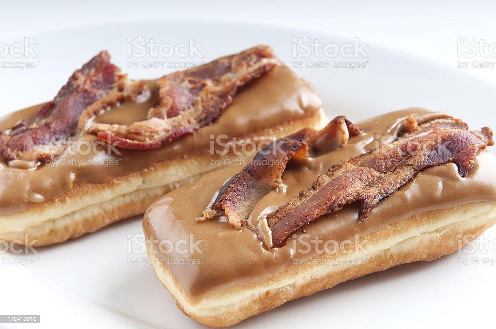 Maple Glazed Doughnut Topped with Bacon royalty-free stock photo