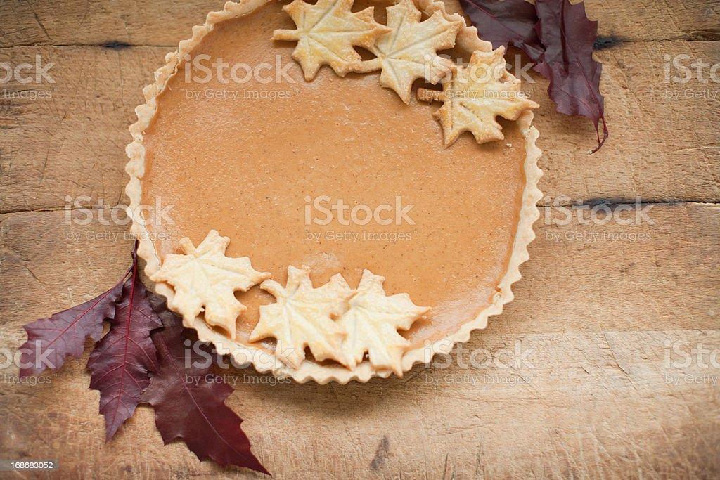 Maple leaf cookies on pumpkin pie royalty-free stock photo