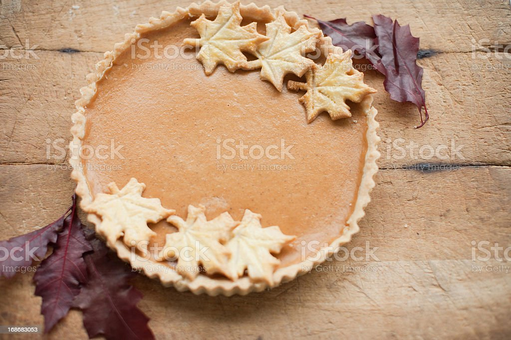 Maple leaf cookies on pumpkin pie stock photo
