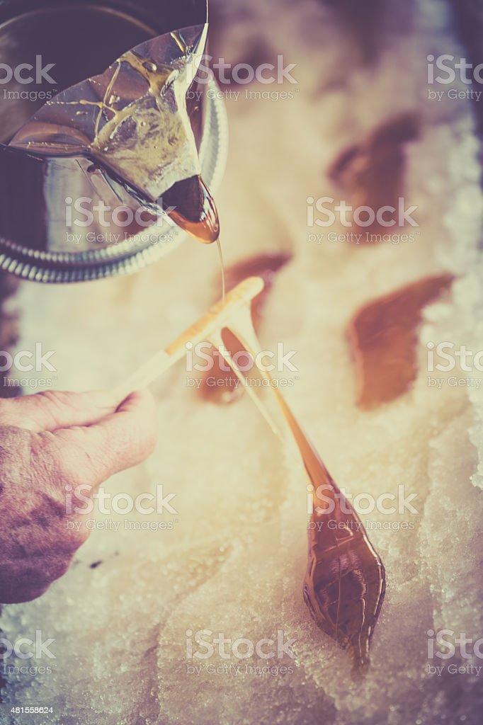 Maple Sugar Taffy on Snow at Sugar Shack stock photo