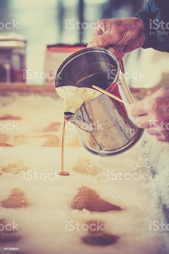 Maple Sugar Taffy on Snow at Sugar Shack stock photo