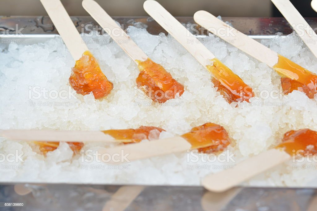 Maple syrup on snow. stock photo