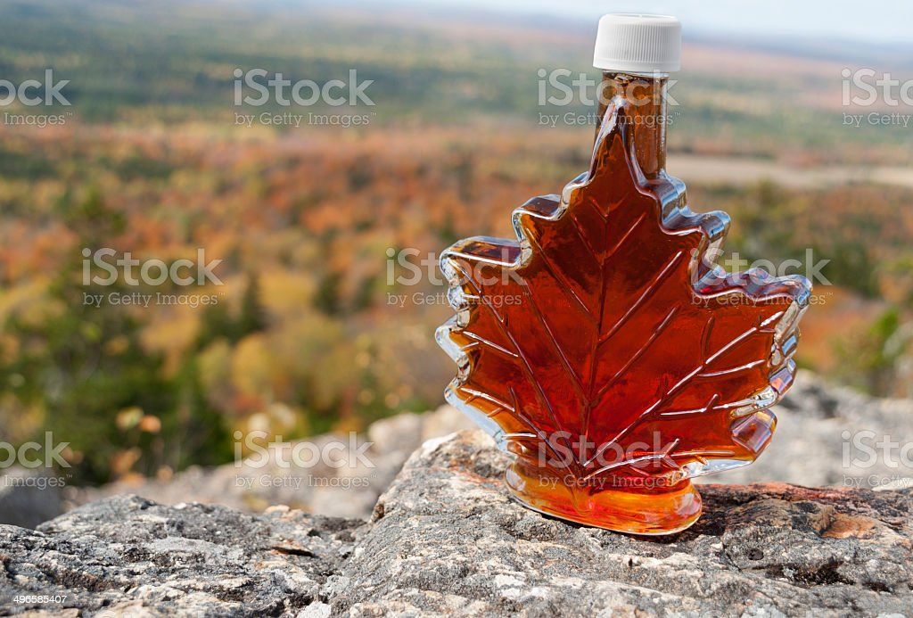 Maple Syrup with Fall Foliage stock photo