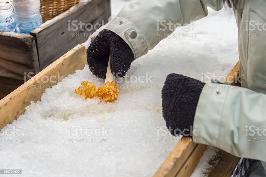 Maple taffy on snow in Montreal, Quebec, Canada stock photo