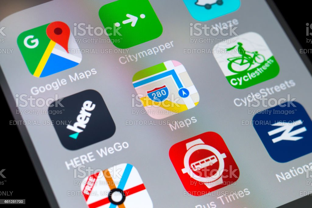 Maps, HERE WeGo, CycleStreets and other travel apps on cellphone stock photo