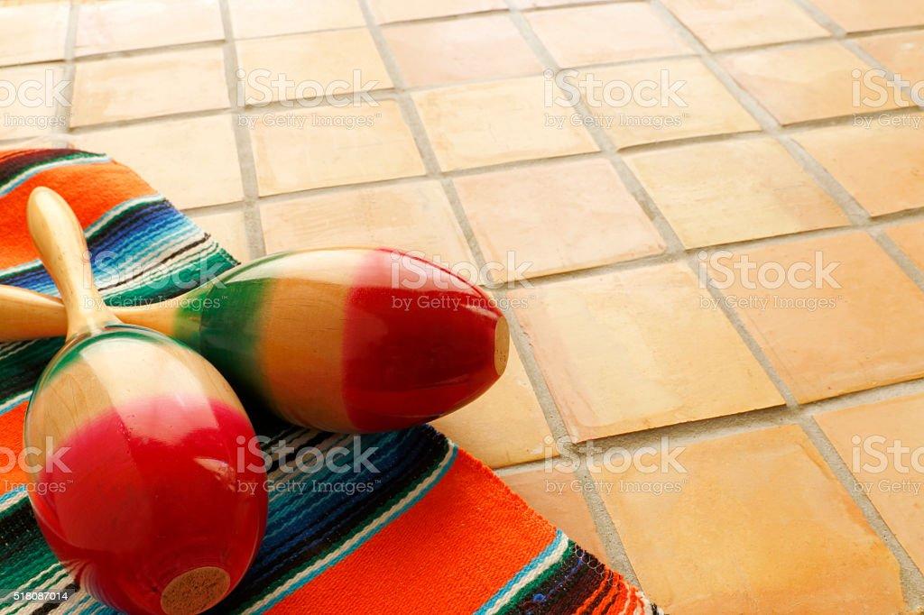 Maracas an Mexican Blanket On Saltillo Tile Background stock photo