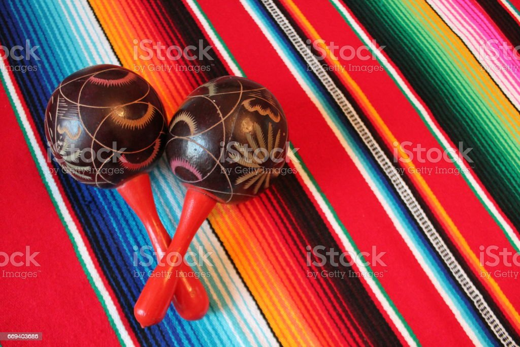 maracas Mexico traditional cinco de mayo rug poncho fiesta background with stripes copy space stock photo