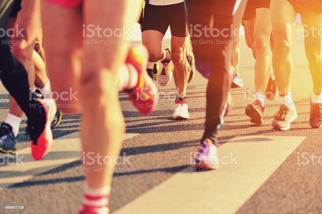 marathon runner legs stock photo