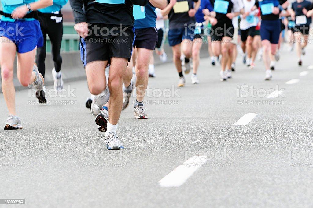 marathon runners close-up stock photo