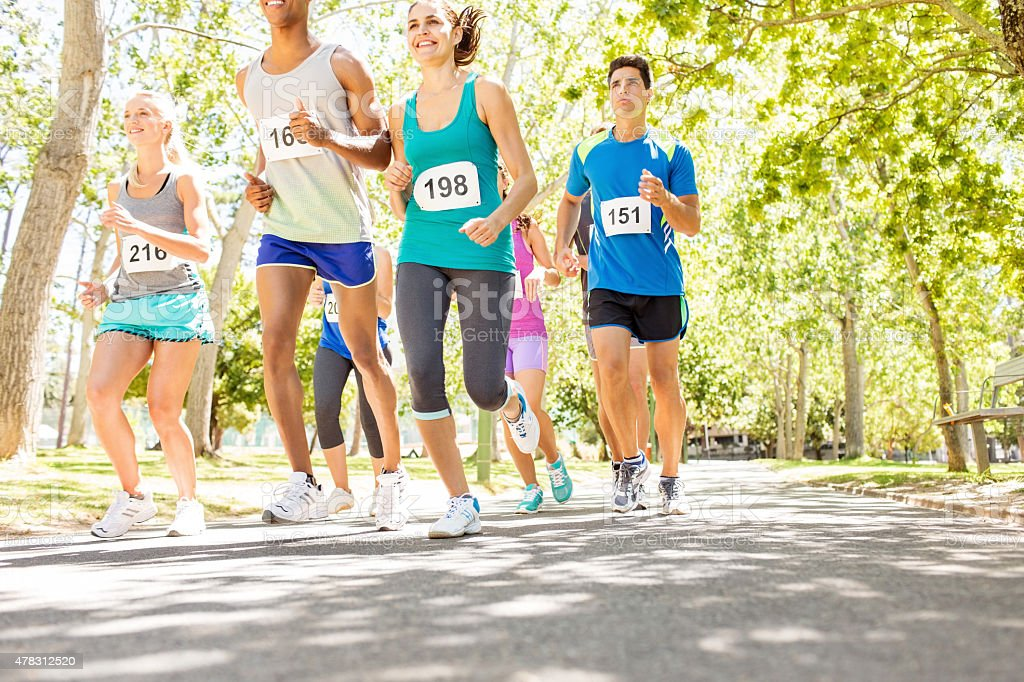 Marathon Runners Competing In Charity Race stock photo