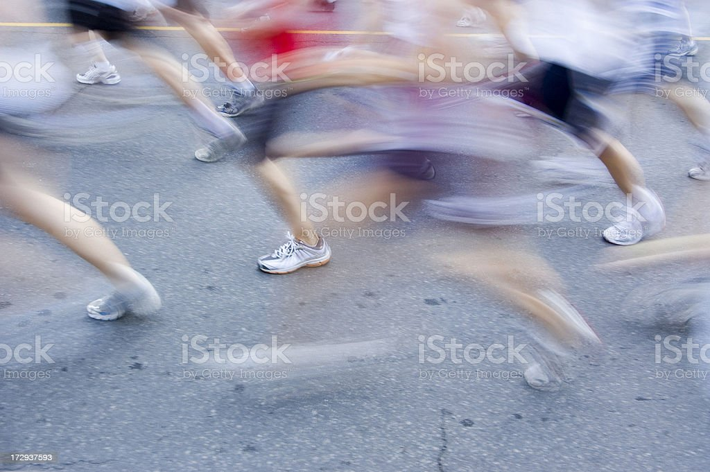 Marathon runners go by in a blur royalty-free stock photo