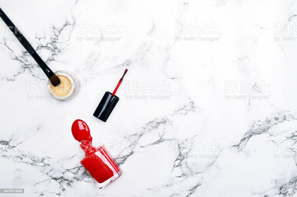 Marble Background with red lacquer. Fashion background. Woman items. View table. Flat lay. Mockup background'n stock photo