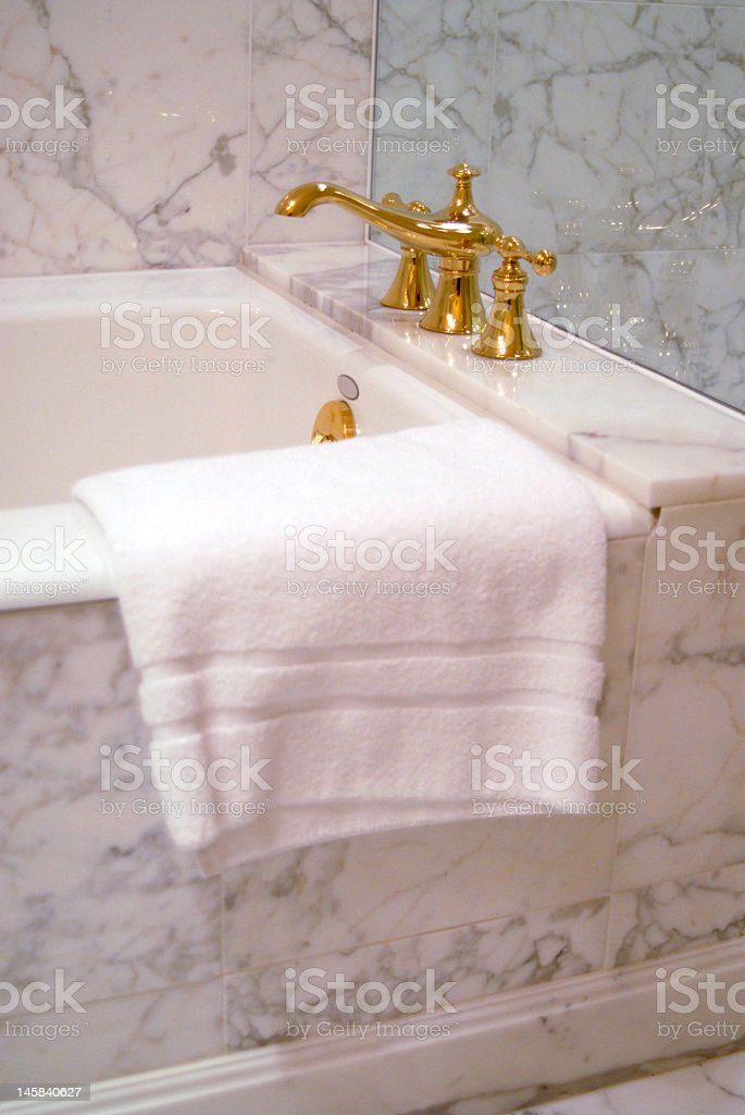 Marble Bathtub with Brass Faucet royalty-free stock photo