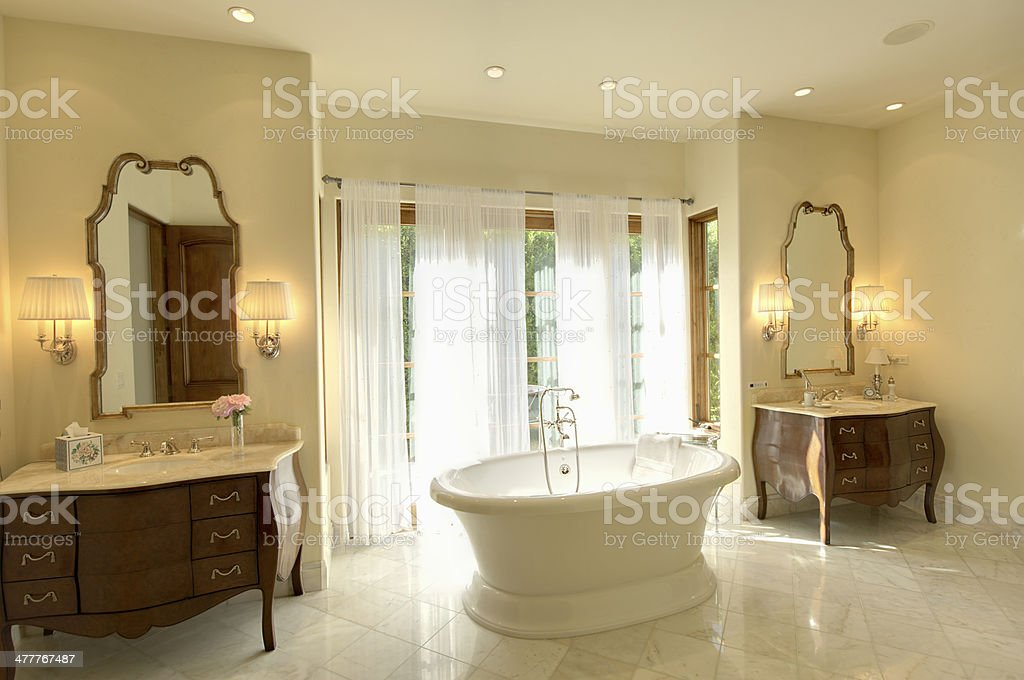 Marble Bathtub With Cabinets And Mirror stock photo