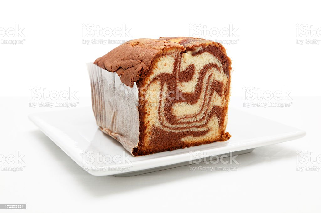 marble cake on square plate textured surface isolated background stock photo