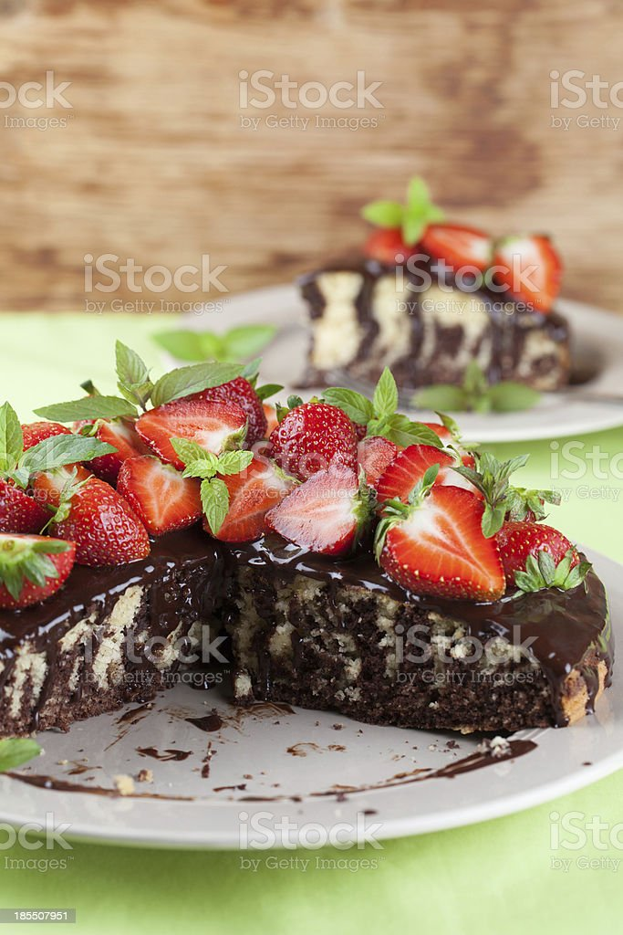 Marble cake with chocolate glaze and strawberries royalty-free stock photo