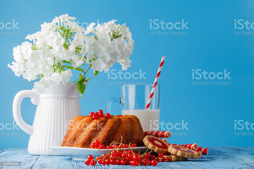 Marble cake with milk on wood background stock photo