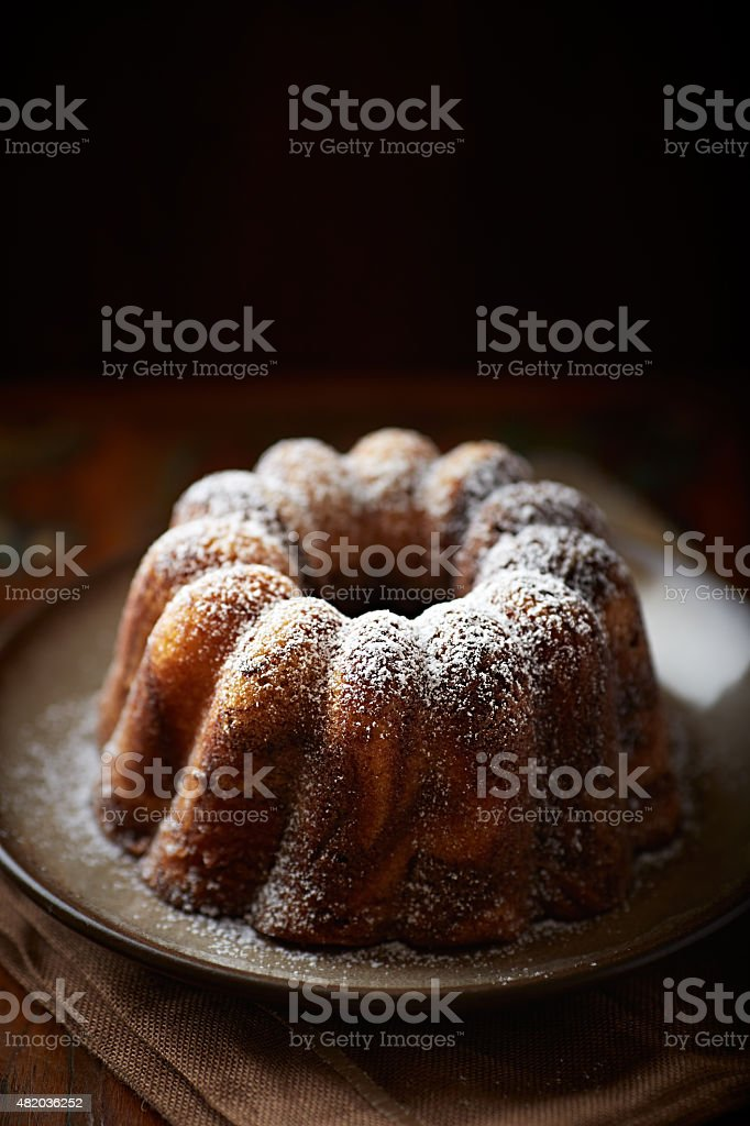 Marble cake with powdered sugar stock photo