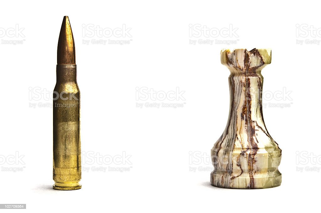 Marble chess tower and riffle bullet isolated on white. royalty-free stock photo